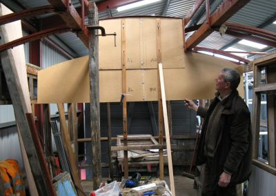 Peter Van Houten tries out the template for the engine room roof which he made from the drawing. The clerestory section was spot on, but the profile of the side sections was slightly out.