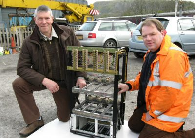 David Moore (right) and Peter Van Houten with the electronics rack which will house the engine control system, wheelslip prevention system and other electronics. This was recovered from a Grand Central HST power car when it was re-engineered, and generously donated to the project by its owners, Angel Trains. The rack has been refurbished and re-wired by Noel Craigen.