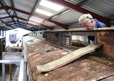 John Birnie in action on the autocar roof, Embsay Carriage shed, 22nd June 2011